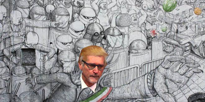 merola vuole sgomberare xm24 nelle vesti del sindaco sauron del murales blu